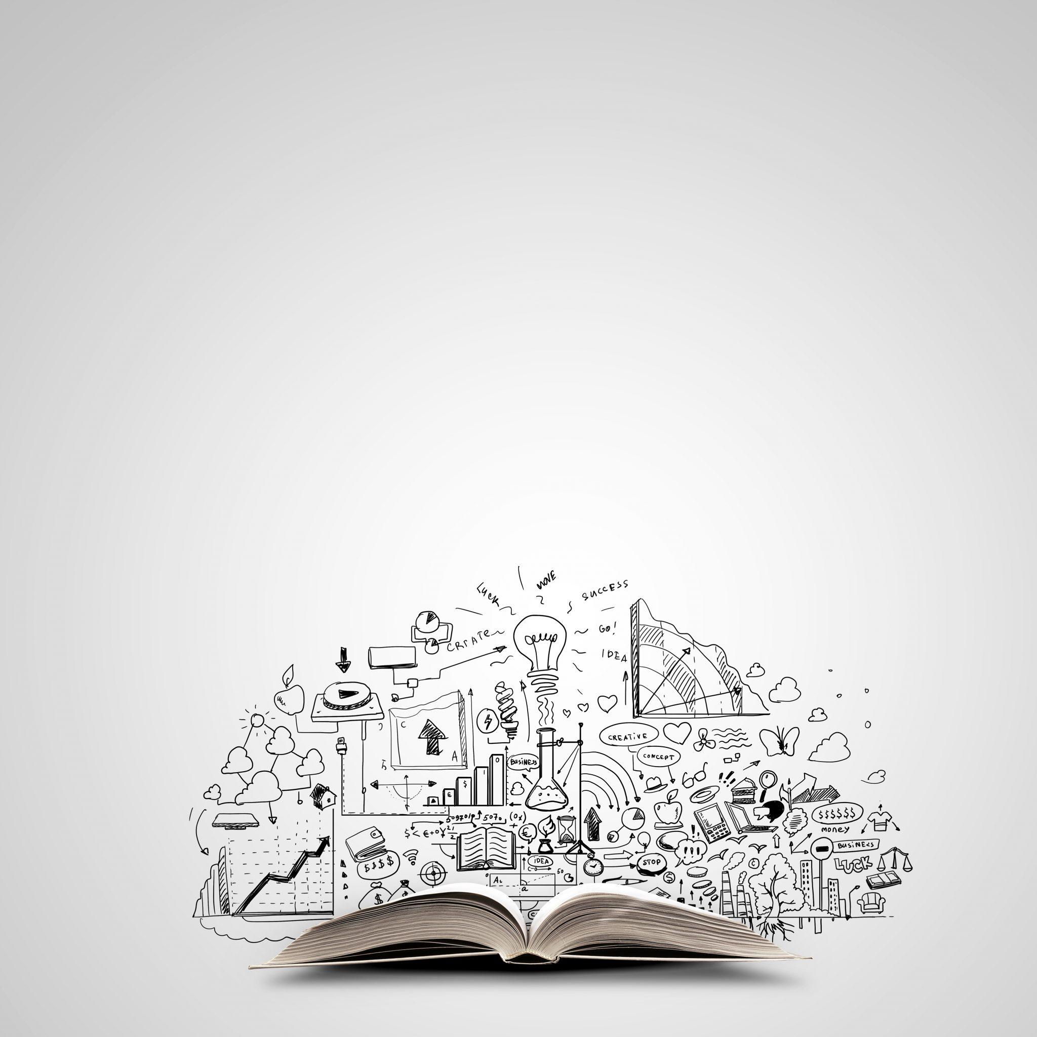 Symbolbild Aufgeschlagenes Buch mit kreativen Symbolen zwischen den Buchseiten