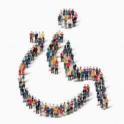 Symbolfoto zur Inklusion: Ein Rollstuhlpiktogramm ist aus einer Gruppe stilisierter Menschen geformt.